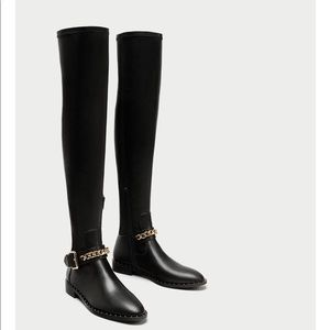 Flat over the knee boots with chain detail
